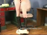 Secretary in stockings stripping and dancing in the office Thumbnail