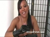 Busty black dominatrix in leather gives handjob to white dick Thumbnail