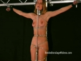 Mature lady is crucified and chained in bondage fetish film Thumbnail