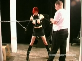 Redhead wearing leather tied up and chained on fetish tape Thumbnail