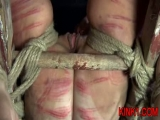 A spreader bar is all it takes to lay Nyssa out and keep her legs opened wide. Thumbnail