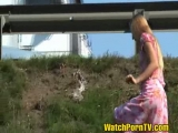 Teen girl walks near t...
