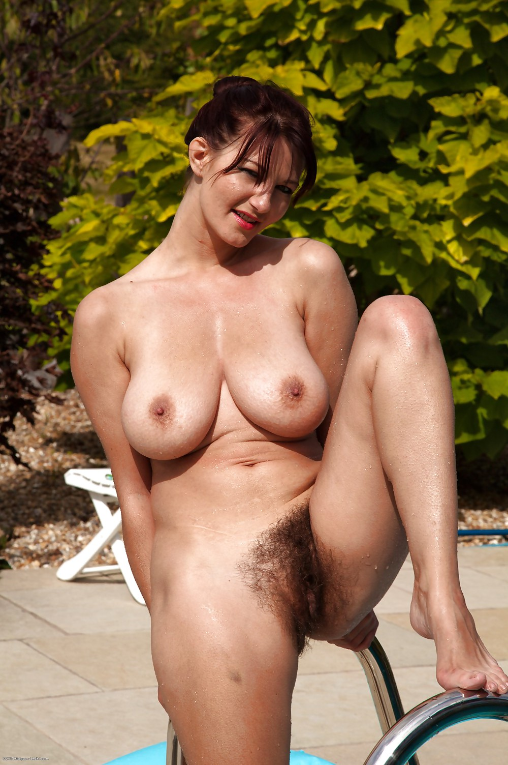 image Woman sunning naked by pool is voyeured
